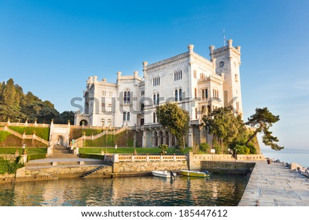 Miramare Castle, Castello di Miramare, in sunset. it is a 19th century castle on the Gulf of Trieste near Trieste, Italy. It was built for Austrian Archduke Ferdinand Maximilian. - stock photo
