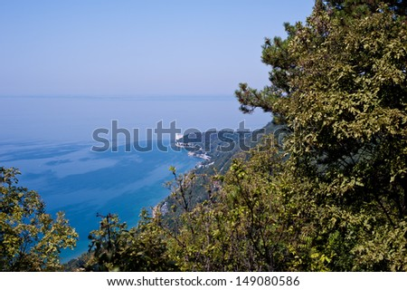 Miramare castle in Trieste seen from above through the vegetation of the via Napoleonica - stock photo