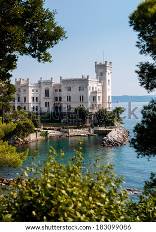 Miramare castle with vegetation frame in italy - Vertical - stock photo