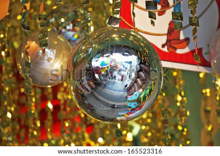 Mirror balls and gold tinsel decorated the hall a luxury hotel. Christmas is coming! - stock photo