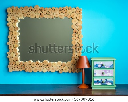 mirror frame with colorful lampshade , modern interior ornament - stock photo