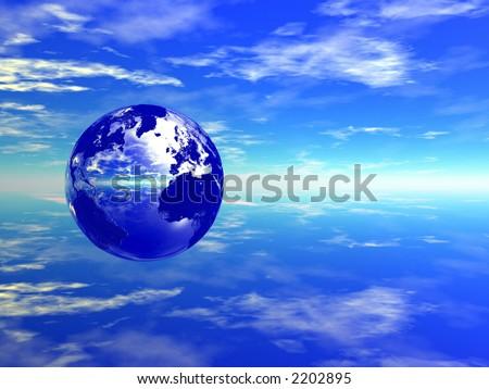 mirror globe in blue sky (left) - stock photo