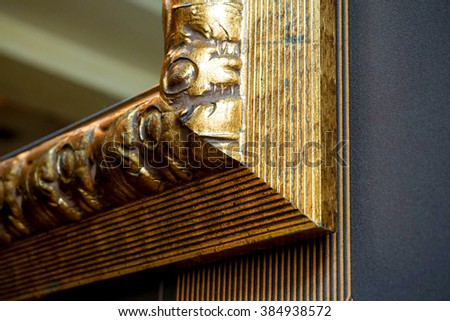 Mirror gold frame with a decorative pattern, detail - stock photo