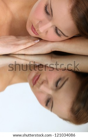 Mirror image of a woman - stock photo