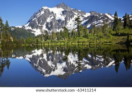 Mirror Image Reflection Lake Mount Shuksan Mount Baker Highway Snow Mountain Trees Washington State Pacific Northwest - stock photo