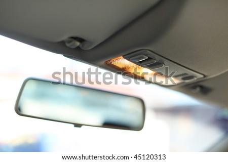 Mirror in car - stock photo