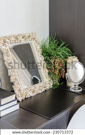 mirror in classic frame style on dressing table at home - stock photo