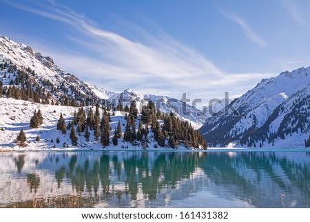 Mirror of mountain soul - emerald mountain lake. Tien-Shan mountains. Canon 5D MkII. - stock photo