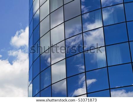Mirror of sky in the windows - stock photo