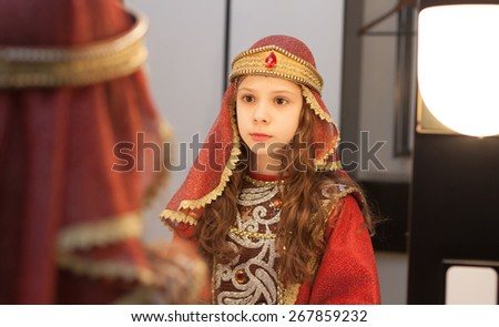 mirror reflection of girl in medieval costume before the performance - stock photo