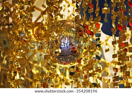 Mirror spheres and gold tinsel decorate a lobby of magnificent hotel. Christmas is fast! - stock photo
