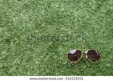 Mirrored aviator sunglasses - stock photo