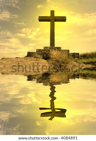mirrored cross silhouette on top of the mountain - stock photo