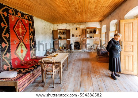 MIRZAANI, GEORGIA - OCT 7: Older woman inside the house-museum of famous Georgian painter Niko Pirosmani in village where he lived last years on October 7 2016. Georgian primitivist lived in 1862-1918