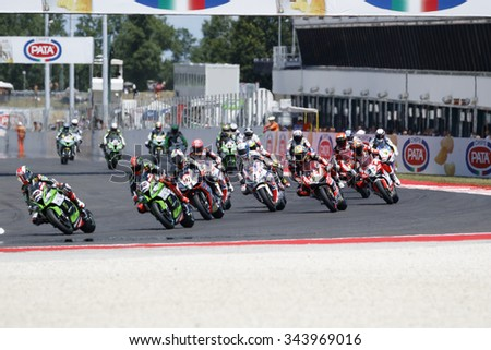 Misano Adriatico, Italy - June 21, 2015: Bikes prepare to leave the grid at the start during race 2 at the Misano World Circuit on June 21, 2015 in Misano Adriatico, Italy.