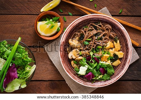 Miso and soba noodle soup with roasted  tofu and  mushrooms. Top view - stock photo