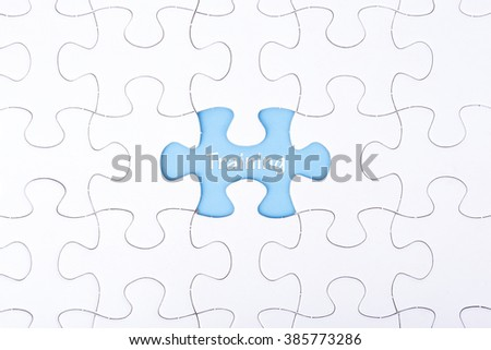 Missing a piece of puzzle in the center, blue space with word TRAINING, business and financial concept. - stock photo