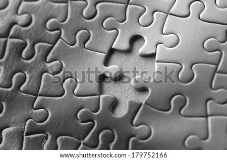 Missing jigsaw puzzle piece. Business concept for completing the final puzzle piece (BW) - stock photo