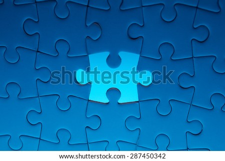 Missing jigsaw puzzle piece with light glow, business concept - stock photo
