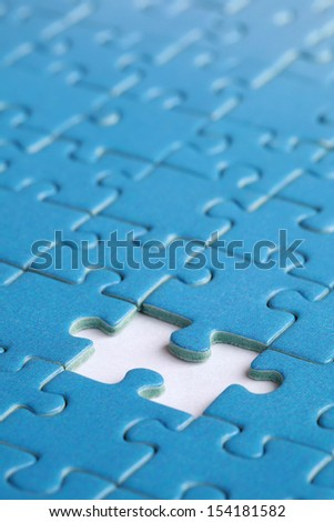 Missing piece in a jigsaw puzzle, concept problem solution - stock photo