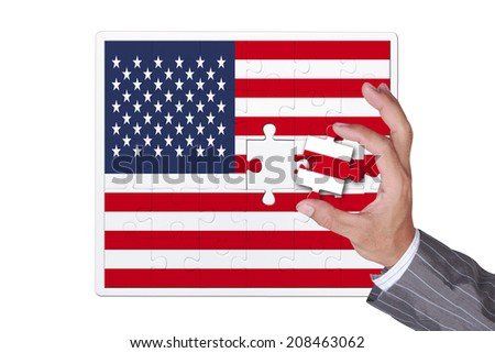 missing puzzle american flag part in business hand for complete nation - stock photo