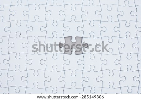 Missing puzzle, concept searching a solution for a problem - stock photo