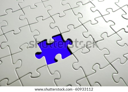 Missing puzzle  piece, focus around the empty space. - stock photo