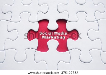 Missing puzzle with Social Media Marketing word - stock photo