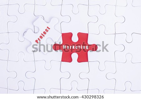 Missing white puzzle with Project, Marketing word and copyspace area