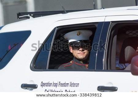 Mission Hills, USA - November 11, 2015: Marine on the car during The San Fernando Valley Veterans Day Parade - stock photo