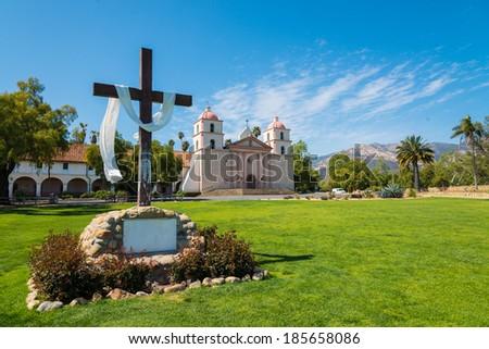 Mission Santa Barbara in Santa Barbara, California with a crosee and a sky blue background - stock photo