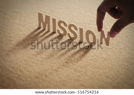 MISSION word of wood alphabet with shadow on cork board,compressed board