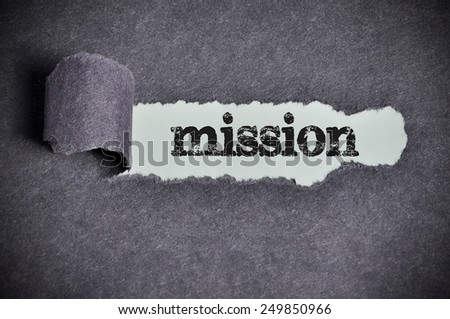 mission  word under torn black sugar paper  - stock photo