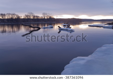 mississippi river in south saint paul minnesota at daybreak in winter along icy banks - stock photo