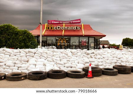 MISSOURI VALLEY, IA - JUNE 9:  A local McDonald's restaurant is surrounded by sand bags in defense of imminent flood waters by the Missouri River on June 9, 2011 in Missouri Valley, IA. - stock photo