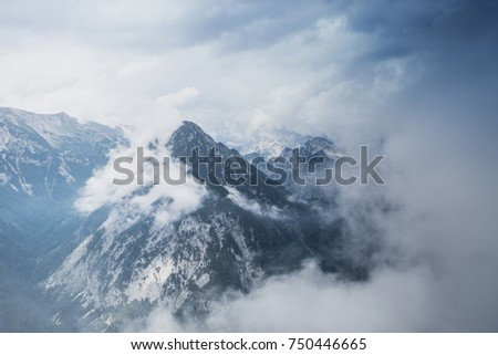 Mist covering the mountain tops in Tirol, Austria.