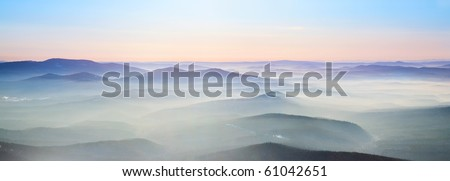 Mist over the mountains. Winter landscape