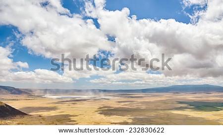Mist rises in the Ngorongoro crater, Ngorongoro Conservation Area, Arusha, Tanzania, Africa - stock photo