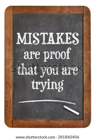 Mistakes are proof that you are trying - motivational text on a vintage slate blackboard - stock photo