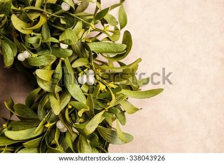 Mistletoe wreath, copy space - stock photo