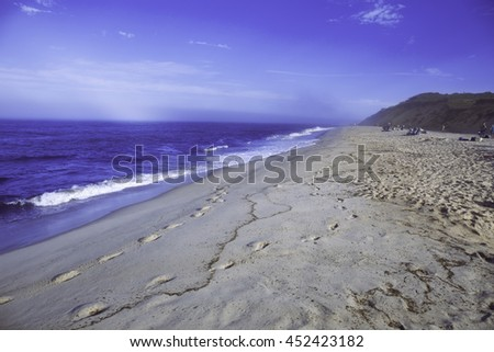 Misty blue beach in Wellfleet, Massachusetts on Cape Cod.