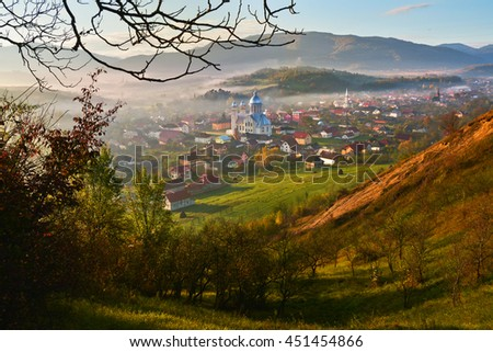 Misty colorful spring landscape in the mountain village, morning in the Carpathian mountains. Ieud, Maramures, Romania, Europe - stock photo