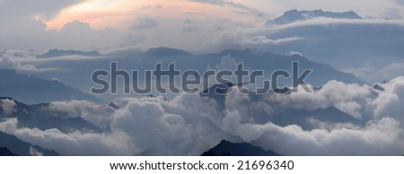 Misty evening of hilly area. Northern Caucasia, Russia. Horizontal panorama.