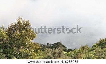 Misty haze above a valley - stock photo