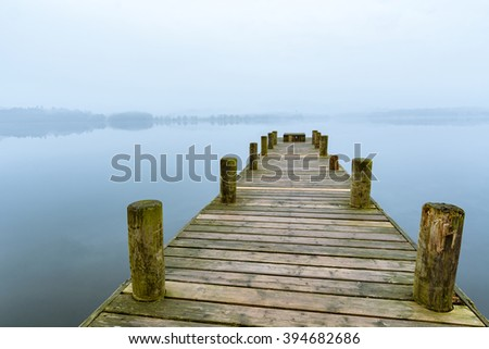 Misty morning at Windermere Jetty in the Lake District, UK. - stock photo
