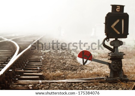 Misty morning by the stony train rails  - stock photo