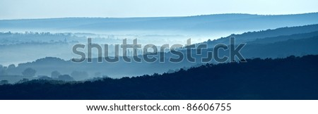 misty morning horizons blue tones - stock photo