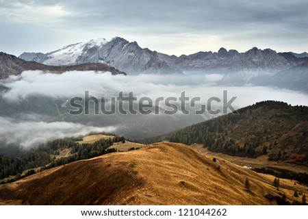 Misty morning in Dolomites, Italy - stock photo