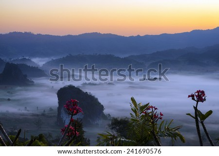 Misty morning light on the top of the mountain hills. Phu Lanka . - stock photo