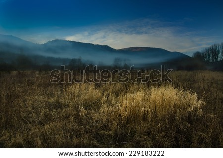 misty morning over the landscape,colorful  morning landscape,beautiful misty autumn panorama - stock photo